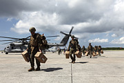 Hangar Prints - Marines Carry Supplies To A Hangar Print by Stocktrek Images