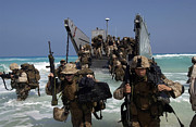 Marines Disembark A Landing Craft Print by Stocktrek Images