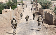 Foot Patrol Photos - Marines Patrol The Streets Of Iraq by Stocktrek Images
