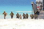 Beachhead Posters - Marines Rush Ashore From A Ling Craft Poster by Stocktrek Images