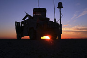 Hmmwv Posters - Marines Take Up A Security Position Poster by Stocktrek Images