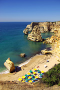 Cliffs Over Ocean Metal Prints - Marinha Beach Metal Print by Carlos Caetano