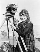 1916 Photos - MARY PICKFORD (1893-1979). Born Gladys Mary Smith. American actress, with a movie camera on a beach, c1916 by Granger