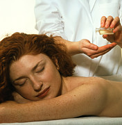 Therapy Prints - Masseuse Pours Oil Before Massaging A Woman Print by Damien Lovegrove
