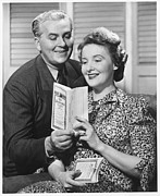 Mature Women Posters - Mature Couple Looking At Brochure, (b&w) Poster by George Marks
