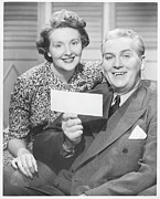 Mature Women Posters - Mature Couple Posing, Man Holding Check, (b&w), Portrait Poster by George Marks