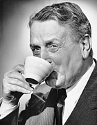 Coffee Drinking Photo Posters - Mature Man Drinking Cup Of Coffee Poster by George Marks