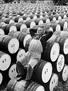 Vintner Framed Prints - Mature Man Relaxing On Barrels (b&w) Framed Print by Hulton Archive