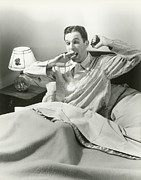 Pajamas Prints - Mature Man Yawning Sitting In Bed Print by George Marks