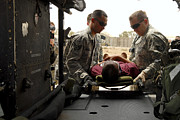 Trauma Prints - Medical Technicians Load An Iraqi Print by Stocktrek Images