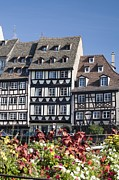Residential Structure Prints - Medieval Timber Style Buildings With Flowers In The Foreground Print by Design Pics / Michael Interisano