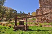 Wine-press Photos - Medieval Wine Press at Castillo de Amoroso by George Sylvia