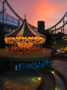 Roller Coaster Posters - Merry-go-round at Sunset Poster by Eena Bo