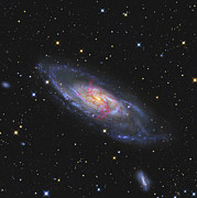 Messier 106, A Spiral Galaxy With An Print by R Jay GaBany