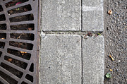 Grate Framed Prints - Metal Grate on Sidewalk Framed Print by Paul Edmondson