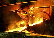 Molten Metal Framed Prints - Metalworks Foundry Worker Framed Print by Ria Novosti