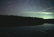 Light Emission Posters - Meteor Over Lake Poster by Pekka Parviainen
