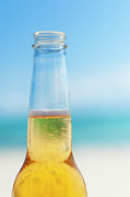 Beer Photo Posters - Mexico, Yucatan, Beer Bottle On Beach Poster by Tetra Images
