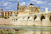 Travel Sightseeing Prints - Mezquita Cathedral and Roman Bridge in Cordoba Print by Artur Bogacki