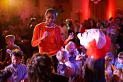 Michelle Obama Metal Prints - Michelle Obama Dancing With Children Metal Print by Everett