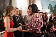 Actors Prints - Michelle Obama Greets Actress Hilary Print by Everett