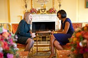 Michelle Obama Framed Prints - Michelle Obama Greets Mrs. Ada Framed Print by Everett