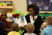 Michelle Obama Framed Prints - Michelle Obama Reads The Cat In The Hat Framed Print by Everett