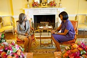 Michelle Obama Framed Prints - Michelle Obama Talks With Elizabeth Framed Print by Everett