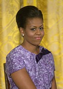 Michelle Obama Framed Prints - Michelle Obama Wearing An Anne Klein Framed Print by Everett