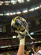 Big 10 Posters - Michigan Helmet Held High Poster by Replay Photos