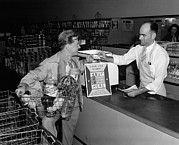 Groceries Posters - Mickey Rooney Paying For His Groceries Poster by Everett