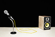 Microphone Stand Prints - Microphone With Yellow Cable Plugged Into Speaker Print by Microzoa