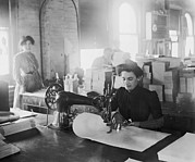 Manufacturing Posters - Middle-aged Women Sewing On A Belt Poster by Everett