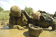 Encouragement Posters - Midshipmen Maneuver Through A Mud Pit Poster by Stocktrek Images