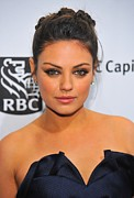 Hair Bun Framed Prints - Mila Kunis At Arrivals For Ifps 20th Framed Print by Everett