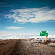 Husky Photo Prints - Milepost at the Dempster Highway Print by Priska Wettstein