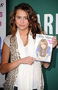 Booksigning Framed Prints - Miley Cyrus At In-store Appearance Framed Print by Everett