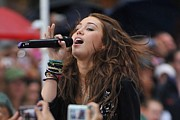 Bracelets Photo Framed Prints - Miley Cyrus On Stage For Nbc Today Show Framed Print by Everett