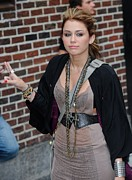 Bracelets Photo Framed Prints - Miley Cyrus, Visits Late Show With Framed Print by Everett