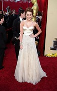 Strapless Dress Photo Framed Prints - Miley Cyrus Wearing A Jenny Packham Framed Print by Everett