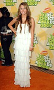 Tiered Dress Posters - Miley Cyrus Wearing A Sheri Bodell Gown Poster by Everett
