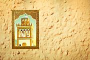 Moroccan Photos - Minaret through a window by Tom Gowanlock