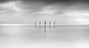 Wooden Post Framed Prints - Minimal Posts Are Arranged Symmetrically In Sea Framed Print by Doug Chinnery
