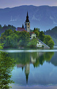 Bled Posters - Mirrored Church at Sunrise Poster by Don Wolf