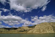Cumulus Clouds Posters - Missouri River Flows Under Cliffs Poster by Gordon Wiltsie