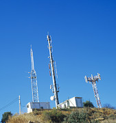 Telecommunications Prints - Mobile Phone Masts Print by Carlos Dominguez