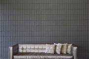 Showcase-interior Photo Framed Prints - Modern Sofa Against a Brick Wall Framed Print by Inti St. Clair