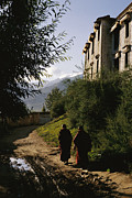 Tibet Framed Prints - Monks Walk Along A Path Framed Print by Justin Guariglia