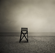 Drab Prints - Moody lifeguard stand on beach. Print by John Greim