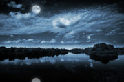 River. Clouds Posters - Moonlight over a lake Poster by Jaroslaw Grudzinski